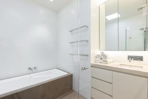 A bathroom at Kensington Self-Contained Modern House (89BROM)