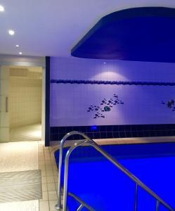 The swimming pool at or near Landhotel Hubertus
