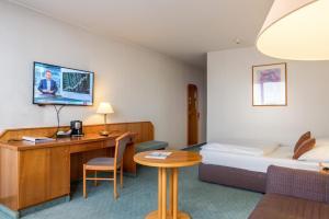 Ein Bett oder Betten in einem Zimmer der Unterkunft Best Western Leoso Hotel Ludwigshafen