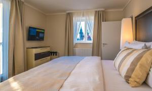 Ein Bett oder Betten in einem Zimmer der Unterkunft Grand Hotel Bohemia