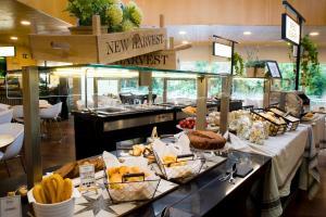 Een restaurant of ander eetgelegenheid bij Ayre Gran Hotel Colón