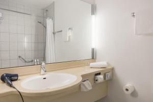 Ein Badezimmer in der Unterkunft Best Western Leoso Hotel Ludwigshafen