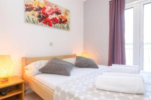 A bed or beds in a room at Apartments in city center Ventus