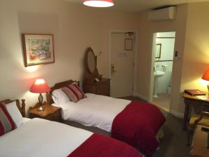 A bed or beds in a room at O'Donovan's Hotel