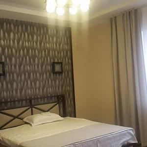 Кровать или кровати в номере Center Hotel