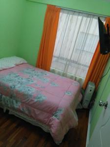 A bed or beds in a room at Mi casa es su casa