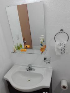 Un baño de MV Suites