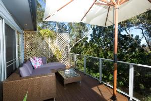 A balcony or terrace at Booti Booti Lakehouse