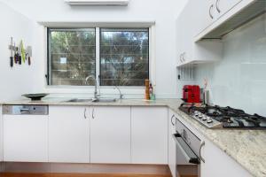 A kitchen or kitchenette at Booti Booti Lakehouse