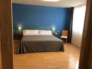 A bed or beds in a room at La Merced de la Concordia
