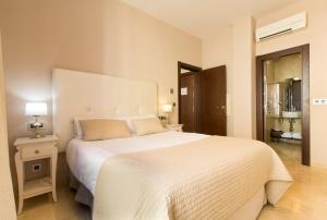 Cama o camas de una habitación en Siloe Plaza