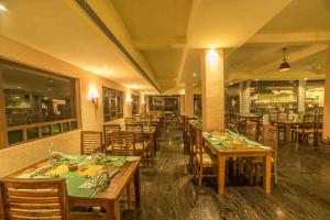 A restaurant or other place to eat at Heritage Resort Hampi