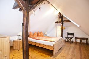 Ein Bett oder Betten in einem Zimmer der Unterkunft Elbterrassen im Wörlitzer Winkel