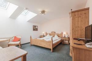 Ein Bett oder Betten in einem Zimmer der Unterkunft Hotel Zur Schanz