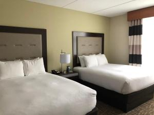 A bed or beds in a room at Wyndham Garden Buffalo Downtown