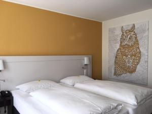 Ein Bett oder Betten in einem Zimmer der Unterkunft Das Goldene Lamm Aalen