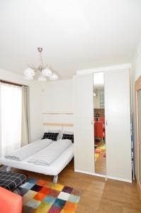 Łóżko lub łóżka w pokoju w obiekcie Apartman Mozartova