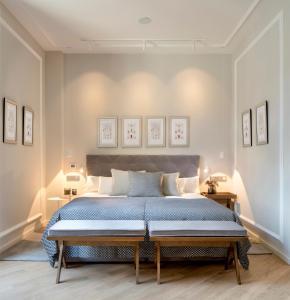 Uma cama ou camas num quarto em Lasala Plaza Hotel