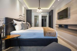 A bed or beds in a room at Classy Design Accommodation
