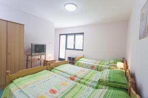Krevet ili kreveti u jedinici u okviru objekta Guest House SokoDream