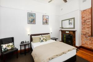 A bed or beds in a room at Pier Hotel