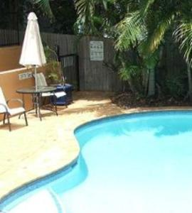The swimming pool at or near Meridian Caloundra