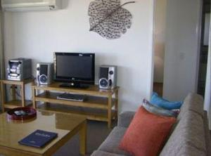 A television and/or entertainment center at Meridian Caloundra