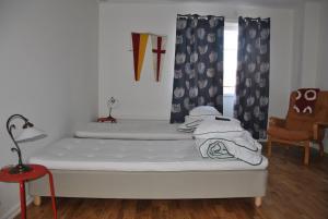 Säng eller sängar i ett rum på Sjöhuset