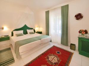 Ein Bett oder Betten in einem Zimmer der Unterkunft Villa Esmeralda