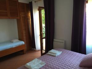 Un ou plusieurs lits dans un hébergement de l'établissement Hotel La Bastide