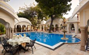 The swimming pool at or near Alsisar Haveli - Heritage Hotel