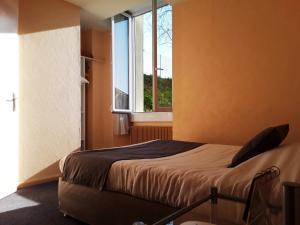 Un ou plusieurs lits dans un hébergement de l'établissement Hôtel Evian Express - Terminus
