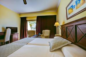 A bed or beds in a room at SBH Costa Calma Palace Thalasso & Spa