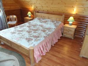 Кровать или кровати в номере Старый Двор