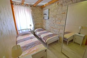 A bed or beds in a room at Villa Giardin