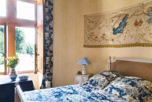 Un ou plusieurs lits dans un hébergement de l'établissement Château de la Roche Martel