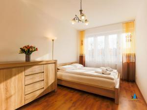 Łóżko lub łóżka w pokoju w obiekcie Zielone Tarasy