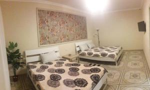 A bed or beds in a room at Guest House on Ayvovaya