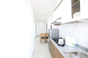 A kitchen or kitchenette at Smile Apartment 11*