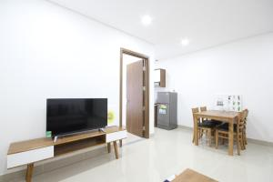 A television and/or entertainment centre at Smile Apartment 11*