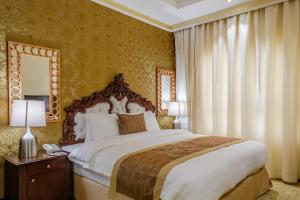 A bed or beds in a room at Tulip Inn Al Khan Hotel
