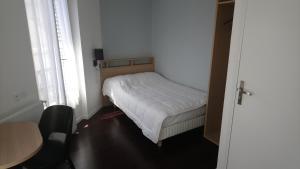 Cama o camas de una habitación en Hotel Rivoli