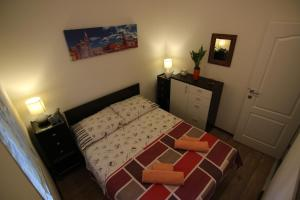 A bed or beds in a room at Zadar Center Apartment