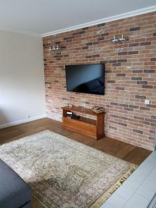 A television and/or entertainment center at Loft by the sea