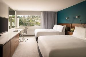 A bed or beds in a room at Andaz West Hollywood-a concept by Hyatt