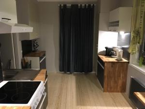 Küche/Küchenzeile in der Unterkunft Rosenfors
