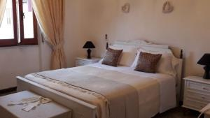 A bed or beds in a room at La Maison de Adele