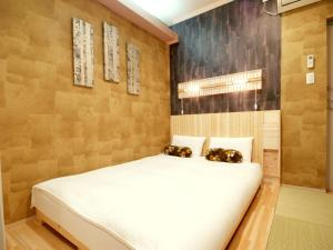 A bed or beds in a room at Guesthouse Nara Komachi