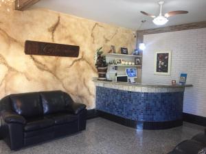 The lobby or reception area at Pousada Castelinho