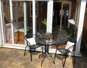 A porch or other outdoor area at 22 Bridus Mead